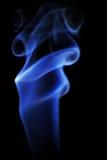 蓝色烟照片在黑背景的 免版税图库摄影