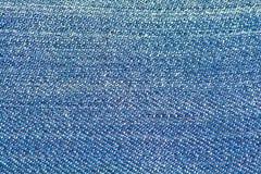 蓝色牛仔布牛仔裤纹理 免版税库存图片