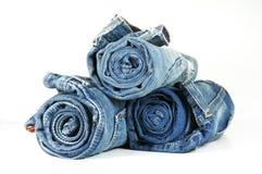 蓝色牛仔裤滚 库存图片