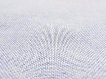 蓝色牛仔裤的浅兰的结构背景特写镜头  了不起的样式 库存照片