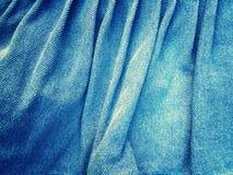 蓝色牛仔裤织品纹理梯度光样式 库存照片