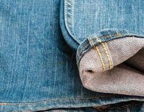 蓝色牛仔布牛仔裤纹理,背景 库存图片