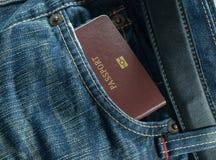 蓝色牛仔裤和护照 免版税库存图片