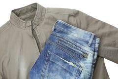 蓝色牛仔裤和棕色夹克 图库摄影