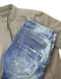 蓝色牛仔裤和棕色夹克 免版税图库摄影