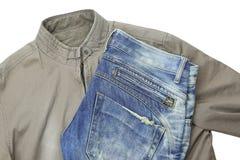 蓝色牛仔裤和棕色夹克 库存照片