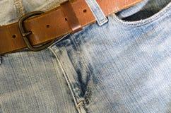 蓝色牛仔裤和皮带 免版税图库摄影