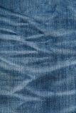 蓝色牛仔裤材料分开纹理 图库摄影