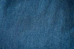 蓝色牛仔裤特写镜头纹理背景 免版税图库摄影