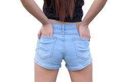 蓝色牛仔裤的身体女性 库存图片