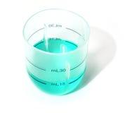 蓝色玻璃液体评定 免版税库存照片