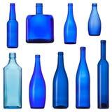 蓝色玻璃瓶集 免版税库存照片