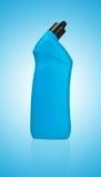 蓝色瓶洗手间的清洁物品 免版税库存照片