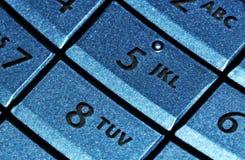 蓝色电池键盘电话 免版税库存照片