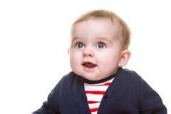 蓝色白色红色成套装备的美丽的愉快的女婴 免版税库存照片