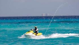 蓝色的喷气式飞机海运滑雪者 库存图片