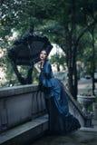 蓝色的维多利亚女王时代的夫人 免版税库存照片