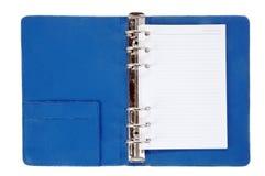 蓝色皮革笔记本 库存图片