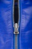 蓝色皮革锁定的拉链 免版税库存图片