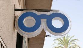 蓝色眼镜师标志 免版税库存图片