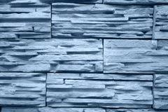 蓝色砖色的轻的墙壁 免版税库存照片