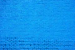 蓝色砖被绘的墙壁 免版税库存图片