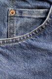 蓝色硬币牛仔布牛仔裤矿穴 免版税库存照片