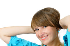 蓝色礼服女孩俏丽微笑 免版税库存图片