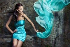 蓝色礼服女孩 库存图片