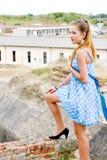 蓝色礼服方式女孩地点短上衣urbex 免版税图库摄影