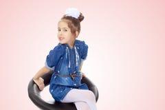 蓝色礼服的小女孩 库存照片