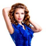 蓝色礼服的肉欲的妇女 免版税库存图片