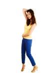蓝色礼服裤子的女孩。 库存图片