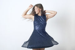 蓝色礼服跳舞的微笑的女孩 免版税库存照片
