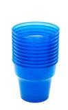蓝色空的塑料杯子 库存图片