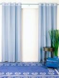 蓝色窗帘 图库摄影