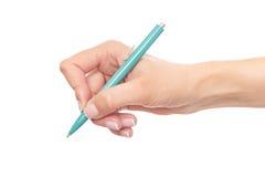 蓝色笔在手中 免版税图库摄影