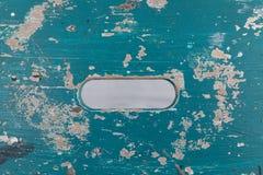 蓝色粗砺的板条顶视图与中心孔的 库存照片