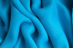 蓝色纺织品纹理背景摘要布料波浪折叠  免版税库存照片