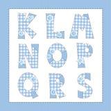 蓝色织品字母表。 库存照片