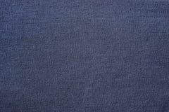 蓝色织品牛仔裤 免版税库存照片
