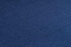蓝色织品纹理 抽象背景,空的模板 免版税库存图片