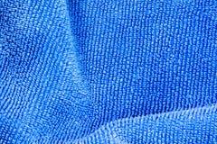 蓝色织品背景的纹理 免版税库存图片