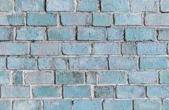 蓝色织地不很细砖墙背景 库存照片