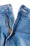 蓝色经典之作关闭斜纹布裤子 免版税库存照片