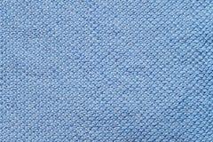蓝色编织的织品纹理背景 图库摄影