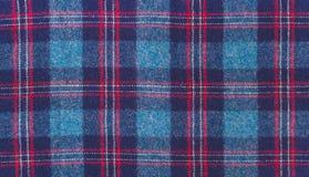 蓝色羊毛方格的织品 免版税库存照片