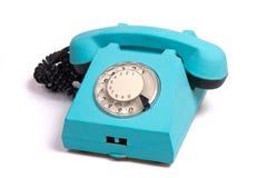 蓝色老电话 免版税库存图片