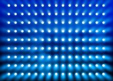蓝色聚光灯墙壁 免版税库存图片
