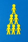 蓝色背景的五颜六色的被堆积的泡沫人民 免版税库存图片
